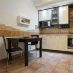 Fully equipped modern kitchen with dining table.
