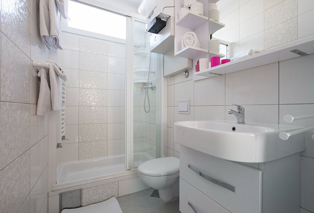 Bathroom with shower, toilet and sink.