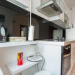 Fully equipped kitchen with stove, microwave, oven dish washer, cattle and fridge.