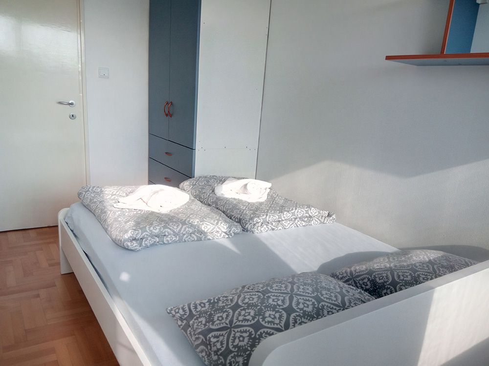 Bedroom with double bed and big closet