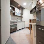 Fully equipped kitchen with big fridge, microwave dishwasher and oven
