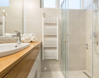 Bathroom with shower, washing machine and big mirror
